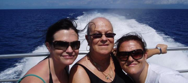 Amanda with her mum and sister on a boat