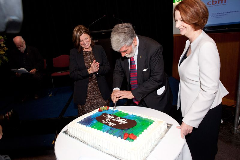 Barry Jones cuts his birthday cake with the Prime Minister