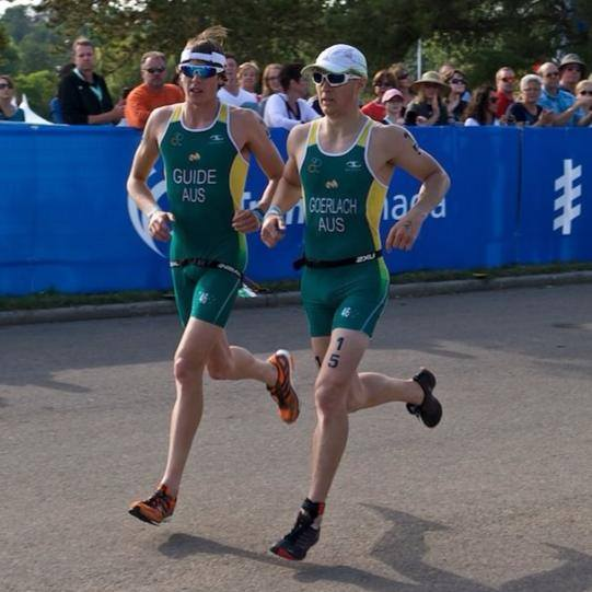Jonathan Goerlach running competitively with his guide