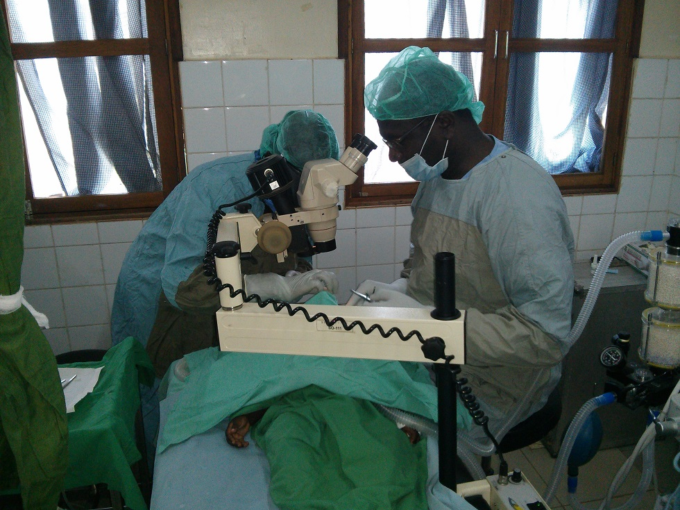 Image of ophthalmologist Dr Geoffrey Wabulembo during surgery