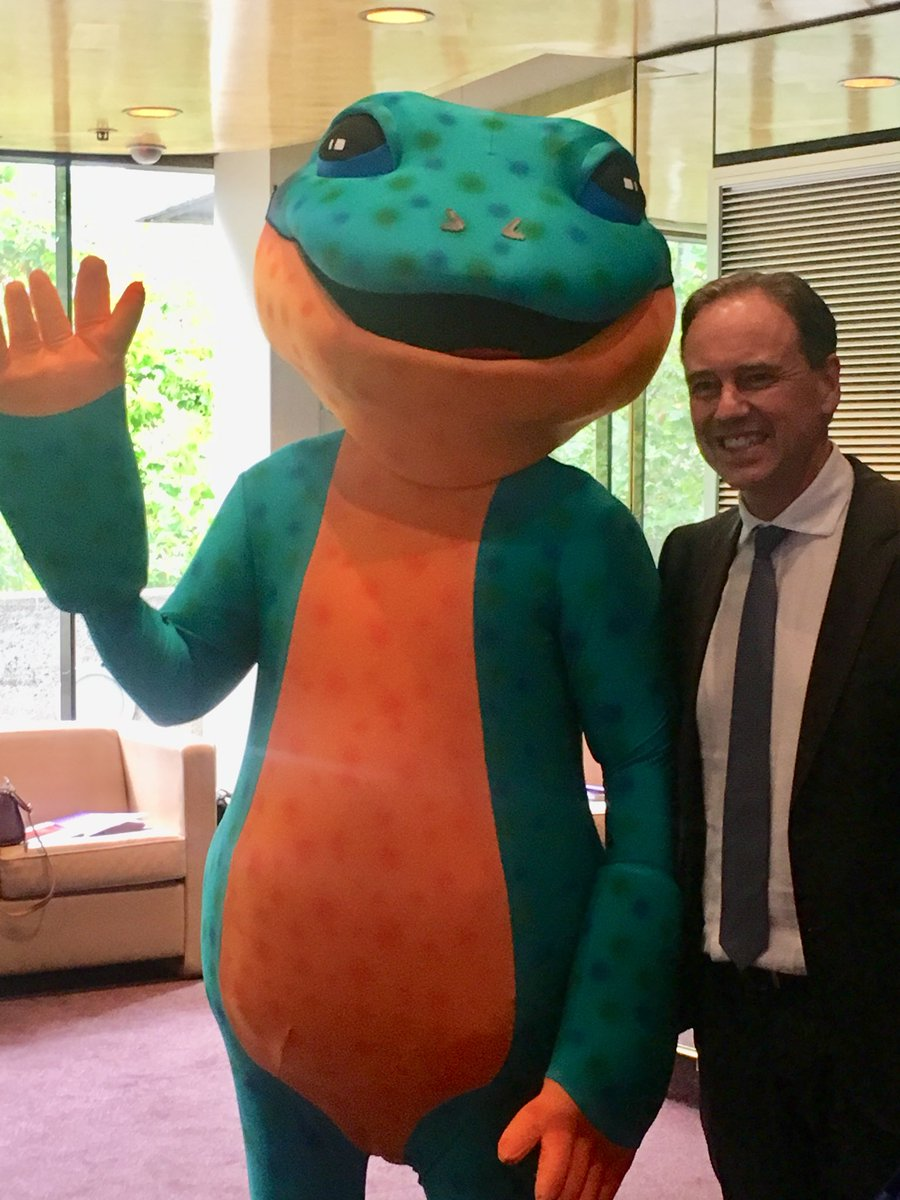 The Minister for Health, the Honorable Greg Hunt, standing next to Milpa the Trachoma Goanna (a person in a large green and orange goanna costume) at the Close the Gap for Vision by 2020 Conference.