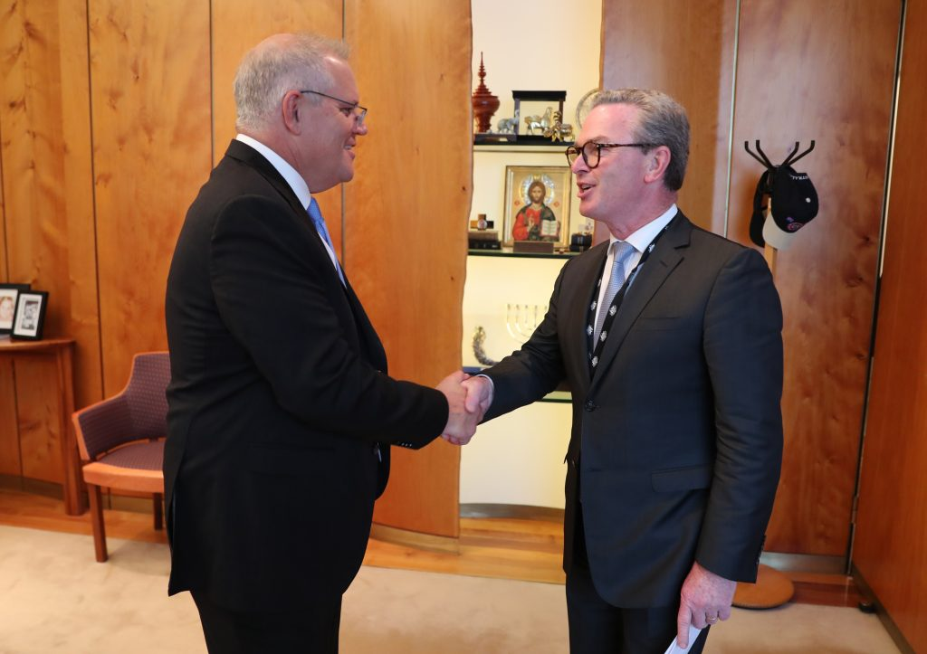 Scott Morrison shaking hands with Christopher Pyne