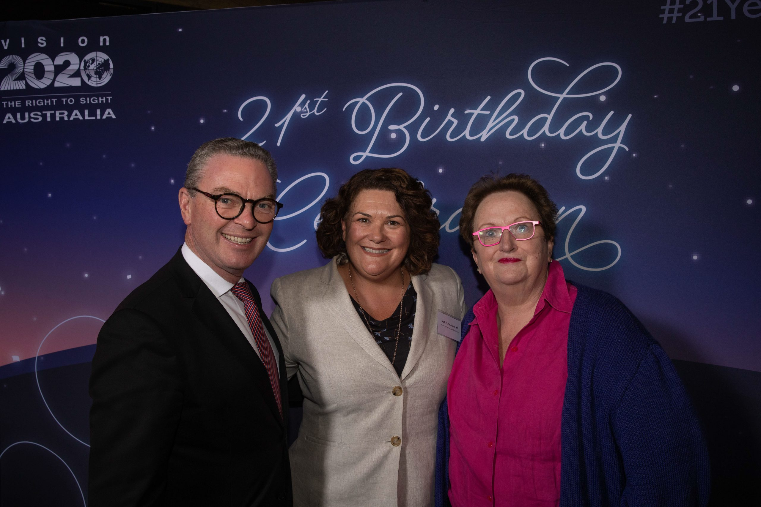 Group of three people at a function